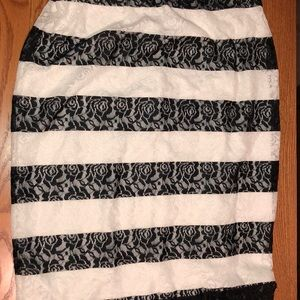 A lacy black and white skirt